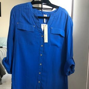 Blue button down with roll up sleeve detail.